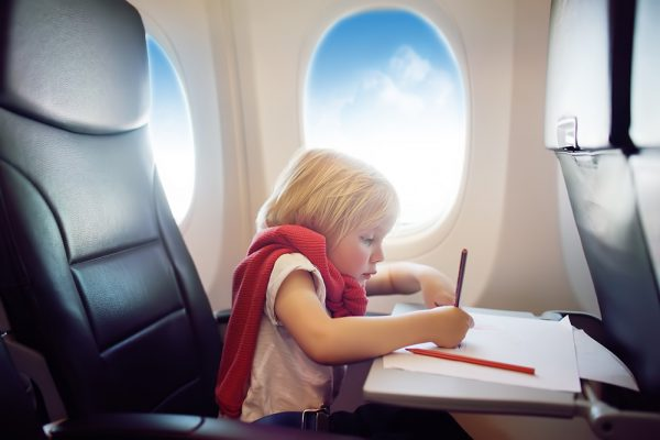 With these airplane travel tips your kid will manage the flight just fine – and so will you!
